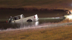 A pickup truck is pulled out of a storm pond in the city's northeast following a single vehicle crash Sunday night