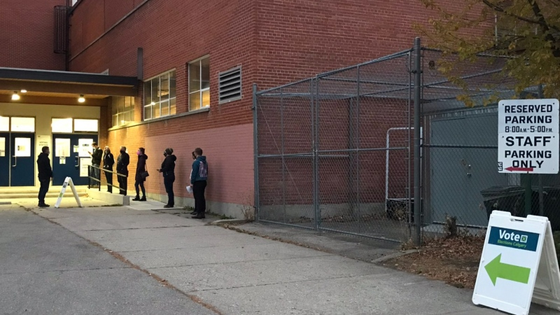 A line of voters outside Crescent Heights High School Monday morning awaiting their opportunity to cast a ballot in the municipal election.