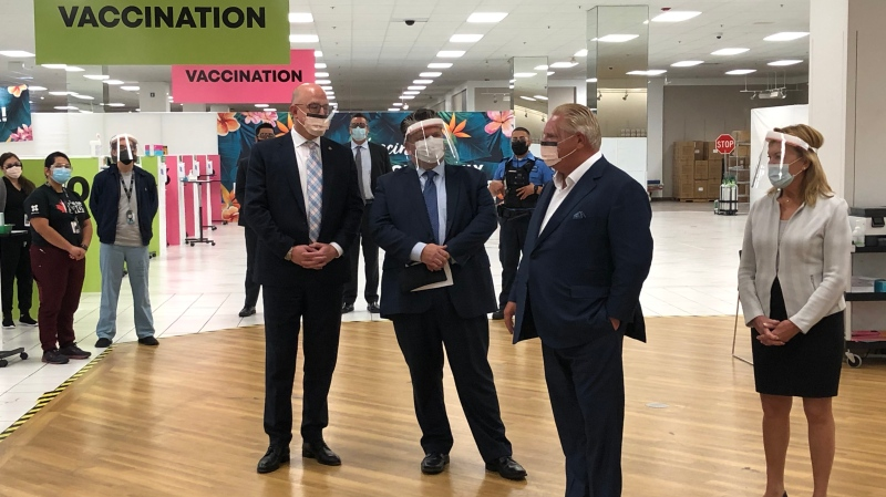 Windsor mayor Drew Dilkens (left), Windsor Regional Hospital CEO David Musyj, Ontario Premier Doug Ford and Health Minister Christine Elliott at the vaccination clinic at Devonshire Mall in Windsor, Ont., on Monday, Oct. 18, 2021. (Angelo Aversa / CTV Windsor)