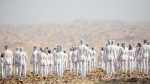 People pose nude for American artist Spencer Tunick as part of an installation in the desert near the Dead Sea, in Arad, Israel, on Oct. 17, 2021. (Ariel Schalit / AP)