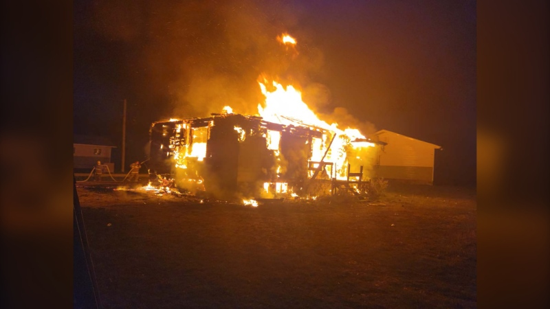 Police said the home on Portage Road in Mosakahiken Cree Nation, Man. was fully engulfed in flames when they arrived on scene. (Source: Manitoba RCMP)