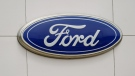 A Ford logo on signage at Country Ford in Graham, N.C., on July 27, 2021 (Gerry Broome / AP)