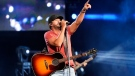 Luke Bryan performs at the Hollywood Casino Amphitheatre in Tinley Park, Ill., on Aug. 21, 2021. (Rob Grabowski / Invision / AP)