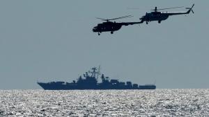 Ukrainian helicopters fly over a Russian warship in the Black Sea, on July 9, 2021. (Efrem Lukatsky / AP)
