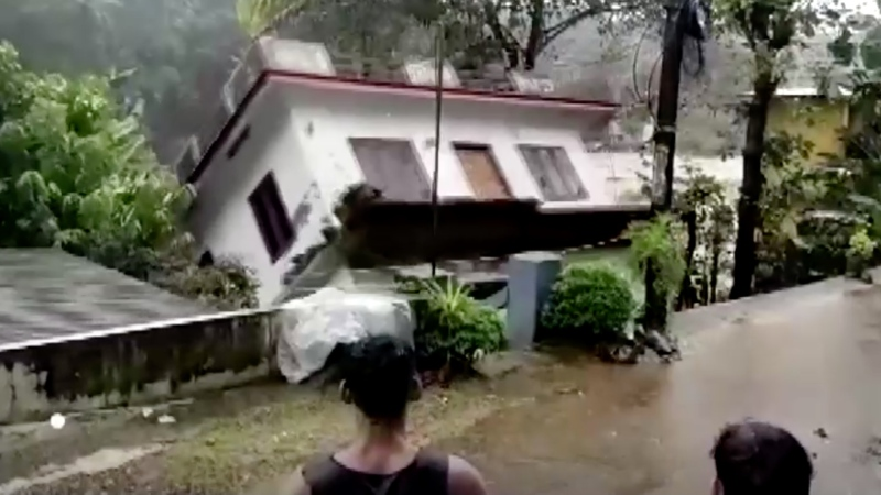 Dramatic video captured by a bystander shows a house being swept up by strong river currents amid heavy rain in the Indian state of Kerala this past weekend. (Kerala government)