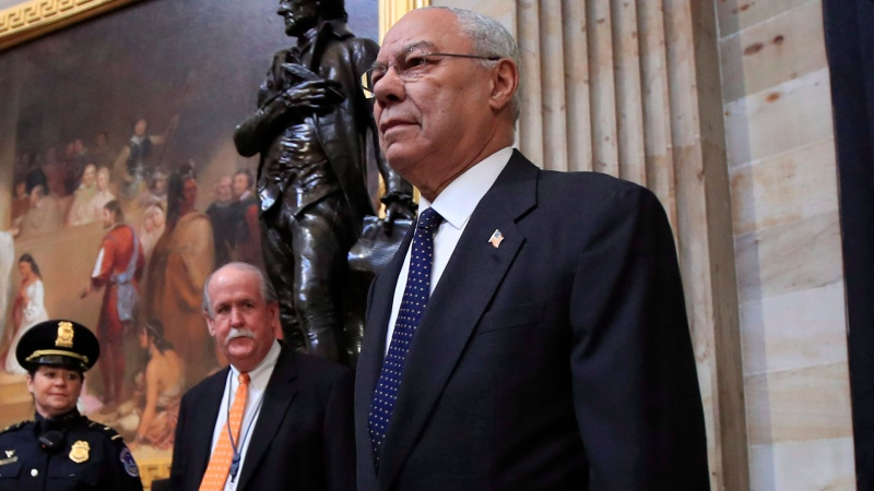 Former Secretary of State Colin Powell, center, leads Desert Storm Commanders to pay their respect to former President George H.W. Bush as he lie in state at the U.S. Capitol in Washington, Tuesday, Dec. 4, 2018. (AP Photo/Manuel Balce Ceneta)