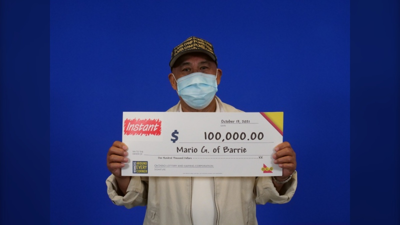 Mario Gurango collects his $100,000 winnings from Instant Wild Card from the OLG Prize Centre in Toronto (Courtesy: OLG)