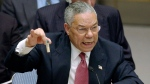 U.S. Secretary of State Colin Powell holds up a vial he said could contain anthrax as he presents evidence of Iraq's alleged weapons programs to the United Nations Security Council, on Feb. 5, 2003. (Elise Amendola / AP)
