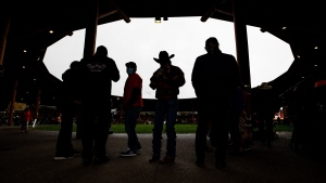 People are silhouetted while attending a Tk'emlups te Secwepemc ceremony to mark the first National Day for Truth and Reconciliation, in Kamloops, BC., on Thursday, September 30, 2021. THE CANADIAN PRESS/Darryl Dyck