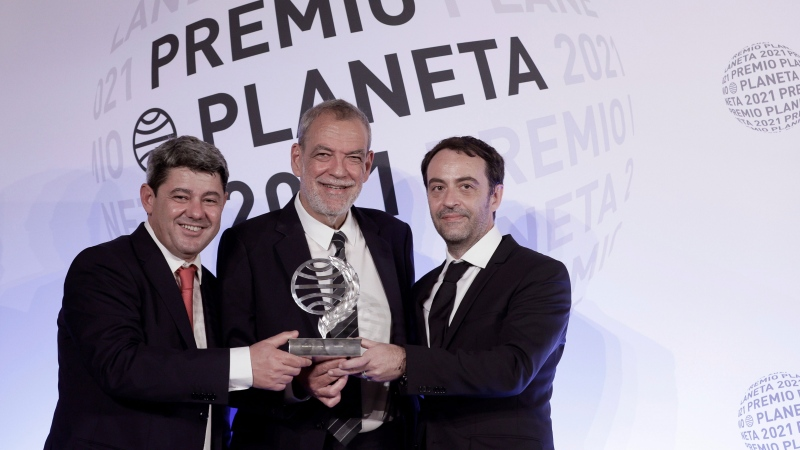 """Spain's literary world has been thrown into chaos after a coveted book prize was awarded to """"Carmen Mola"""" -- an acclaimed female thriller writer who turned out to be the pseudonym of three men, and pictured, spanish writers Agustin Martinez (left), Jorge Diaz (center) and Antonio Mercero (right). (Quique Garcia/EFE/Sipa)"""