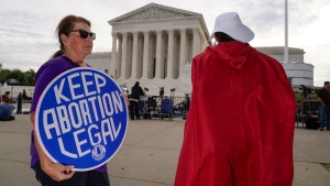 The Supreme Court is seen on the first day of the new term as activists demonstrate on the plaza, in Washington, Monday, Oct. 4, 2021. (AP Photo/J. Scott Applewhite)