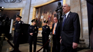 Former U.S. Secretary of State Colin Powell, center, leads Desert Storm Commanders to pay their respect to former President George H.W. Bush as he lie in state at the U.S. Capitol in Washington, Tuesday, Dec. 4, 2018. (AP Photo/Manuel Balce Ceneta)