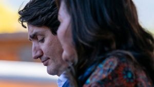 Prime Minister Justin Trudeau bows his head as he listens to chief Rosanne Casimir at Tk'emlups the Sewepemc in Kamloops, B.C. Monday, Oct. 18, 2021. THE CANADIAN PRESS/Jonathan Hayward