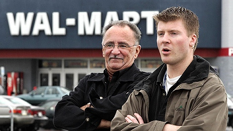 Pierre Martineau, left, and Patrice Bergeron, two of the Wal-Mart workers who initiated the unionization, stand in front of their workplace, a Wal-Mart department store, Tuesday Sept. 28, 2004 in Jonquiere, Que. (CP PHOTO/Jacques Boissinot)
