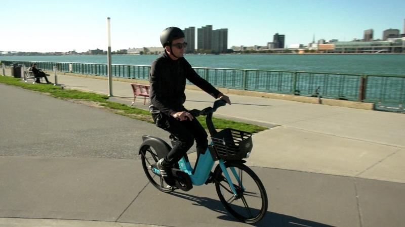 Bird Canada representative Stephen Hargreaves rides a Bird e-bike along Windsor's riverfront on Oct. 18, 2021. (Rich Garton/CTV Windsor)