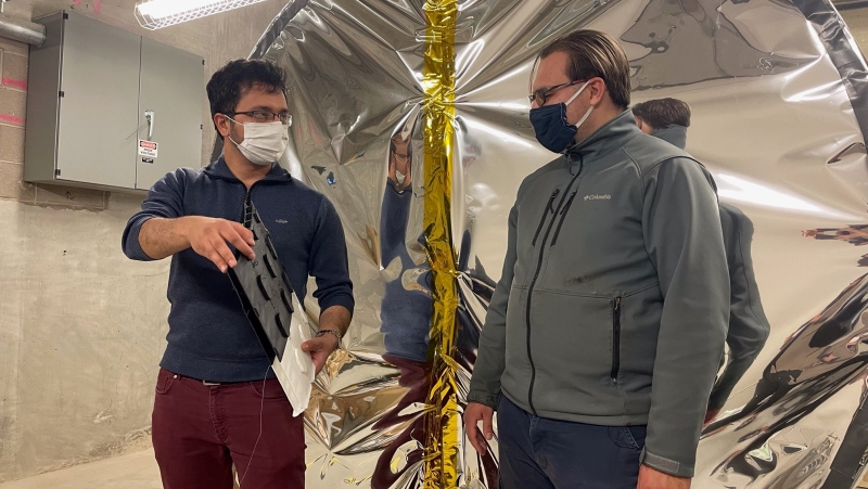 Anwit Adhikari (left) and Samuel Reddekop (right) are part of a team of approximately 30 people who have worked on this airlock prototype over the past three years. (Stefanie Davis/CTV News)