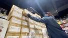 Staff at Toys on Fire, Barrhaven stocking shelves. (Peter Szperling / CTV News Ottawa)