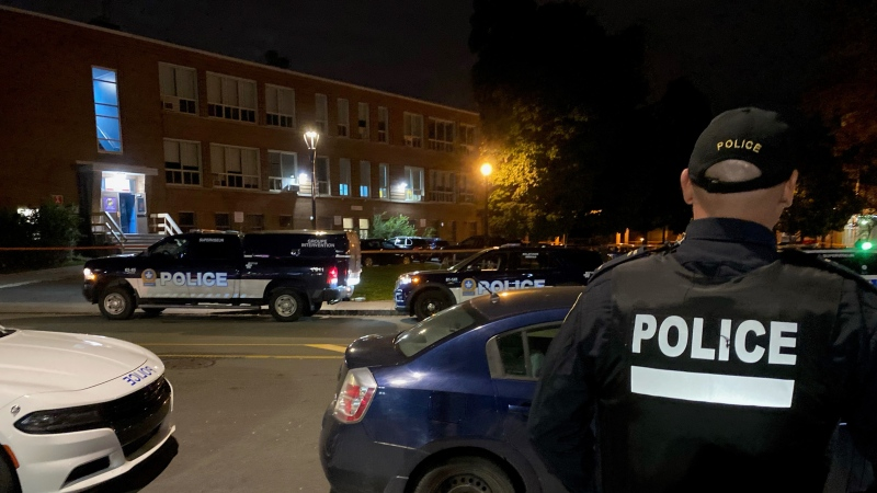 Police arrive on scene to investigate the death of a 16-year-old boy in Cote-des-Neiges. (Photo: Cosmo Santamaria)