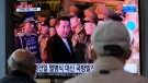 People watch a TV screen showing an image of North Korean leader Kim Jong Un during a news program at the Seoul Railway Station in Seoul, South Korea, Tuesday, Oct. 12, 2021. (AP Photo/Ahn Young-joon)