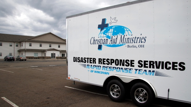 This Sunday, Oct. 17, 2021 photo shows the logo for Christian Aid Ministries in Berlin, Ohio, on a vehicle. (AP Photo/Tom E. Puskar)