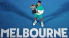 Feb. 21, 2021, file photo Serbia's Novak Djokovic holds the Norman Brookes Challenge Cup after defeating Russia's Daniil Medvedev in the men's singles final at the Australian Open tennis championship in Melbourne, Australia. (AP Photo/Hamish Blair, File)