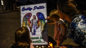 After details about the circumstances of her death were announced to the public, Gabby Petito's parents are finally bringing home the remains of their 22-year-old daughter, and pictured, people honour her in New York on Sept. 24. (Stephanie Keith/Getty Images via CNN)