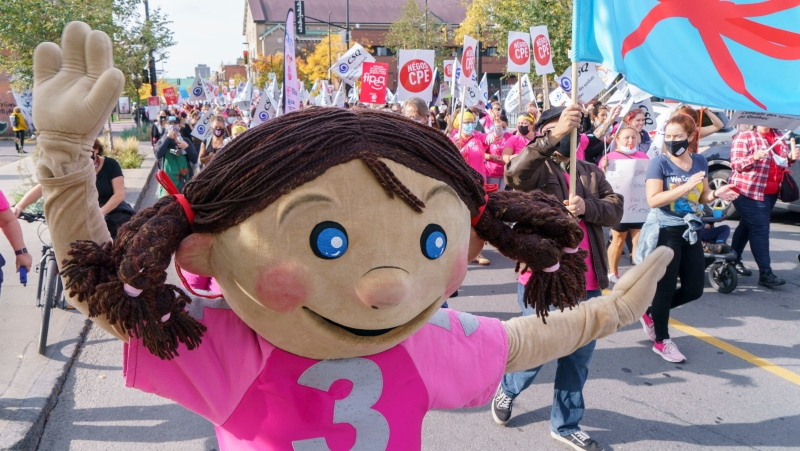 Daycare workers demonstrate on the first day of rotating strikes in Montreal on Tuesday, October 12, 2021. THE CANADIAN PRESS/Paul Chiasson