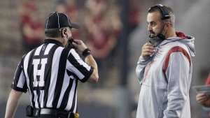 Washington State head coach Nick Rolovich, right, speaks with an official during an NCAA college football game in Pullman, Wash., on Sept. 4, 2021. (Young Kwak / AP)