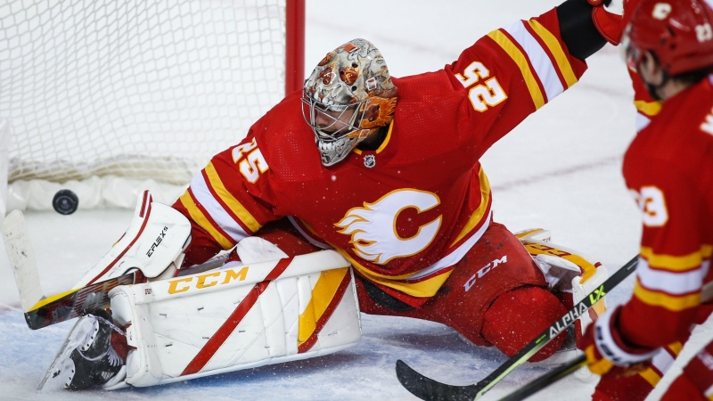 Calgary Flames goalie Jacob Markstrom lets in the winning goal during overtime of an NHL hockey game against the Anaheim Ducks, in Calgary on Oct. 18, 2021. (Jeff McIntosh/The Canadian Press)