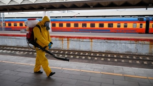 An employee of the Federal State Centre for Special Risk Rescue Operations of Russia Emergency Situations disinfects Leningradsky railway station in Moscow, Russia, on Oct. 19, 2021. (Alexander Zemlianichenko Jr / AP)