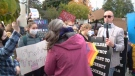 Dozens gathered to protest an anti-trans activist outside a west Ottawa school on Tuesday morning. (CTV Morning Live)