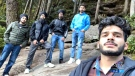Young men rescue hikers by creating makeshift rope