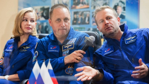 From left: actor Yulia Peresild, cosmonaut Anton Shkaplerov, director Klim Shipenko attend a news conference at the Russian launch facility in the Baikonur Cosmodrome, Kazakhstan, on Oct. 4, 2021. (Roscosmos Space Agency via AP)