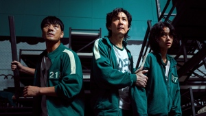 This undated photo released by Netflix shows South Korean cast members, from left, Park Hae-soo, Lee Jung-jae and Jung Ho-yeon in a scene from 'Squid Game.' (Youngkyu Park/Netflix via AP)