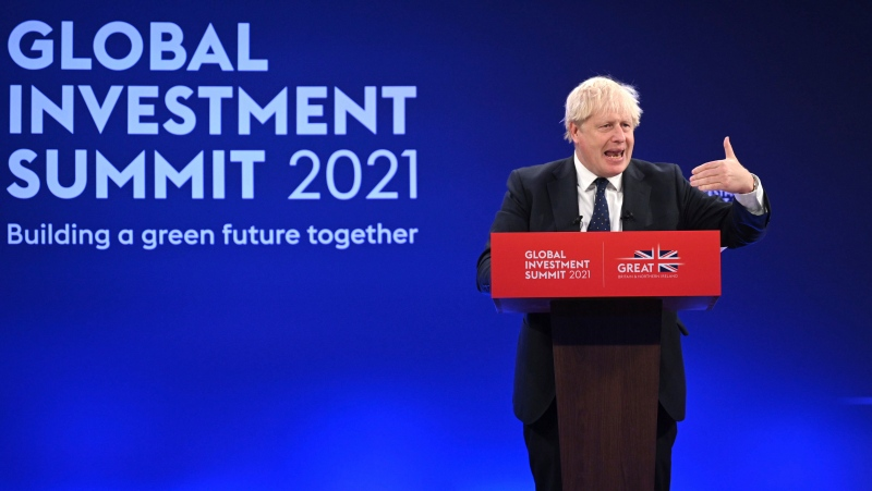 Prime Minister Boris Johnson delivers a speech during the Global Investment Summit at the Science Museum, London, Tuesday, Oct, 19, 2021. (Leon Neal/Pool Photo via AP