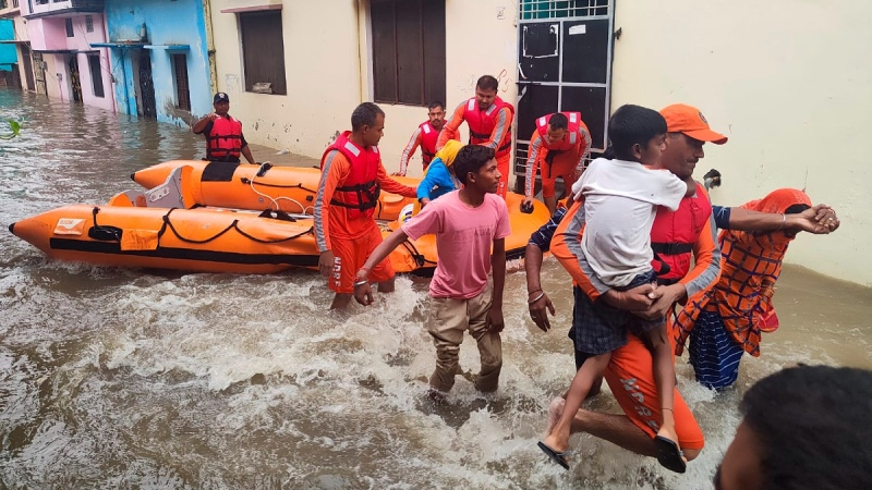 India's National Disaster Response Force (NDRF) soldiers rescue people stranded in floodwaters in Udham Singh Nagar, Uttarakhand state, India, on Oct. 19, 2021.  (National Disaster Response Force via AP)