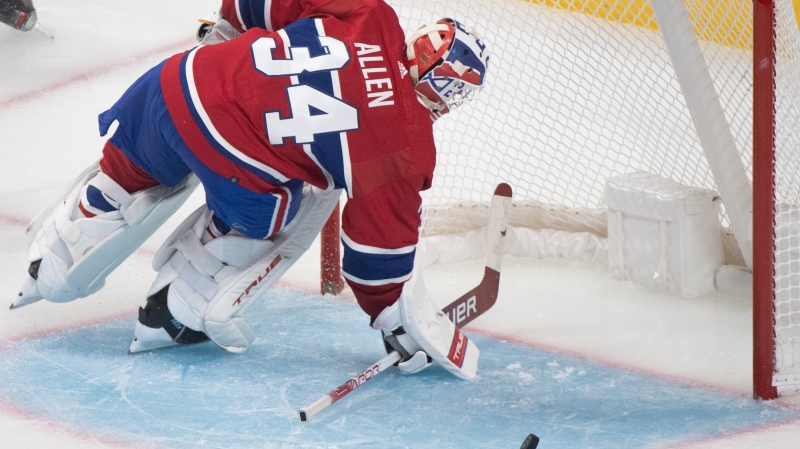 Montreal Canadiens goaltender Jake Allen is scored on by New York Rangers' Alexis Lafreniere (not shown) during third period NHL hockey action in Montreal, Saturday, October 16, 2021. THE CANADIAN PRESS/Graham Hughes