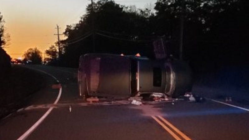 A truck rests on its side after rolling on Peninsula Road in Muskoka Lakes Township, Ont., on Mon., Oct. 18, 2021 (Muskoka Lakes Fire Department)