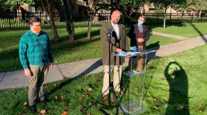 From left, Nawton Chiles, co-chair of London ACORN, London North Centre NDP MPP Terence Kernaghan and renter Davis Whittington-Heeney in London, Ont. on Tuesday, Oct. 19, 2021. (Bryan Bicknell / CTV News)