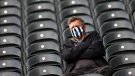 A fan of Newcastle wears a face mask prior to the English Premier League soccer match between Newcastle United and Sheffield United at St. James' Park, on May 19, 2021. (Alex Pantling / Pool via AP)
