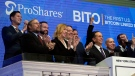ProShares CEO Michael Sapir, second right, and company Global Investment Strategist Simeon Hyman, right, lead the New York Stock Exchange opening bell celebration, Tuesday, Oct. 19, 2021. (AP Photo/Richard Drew)