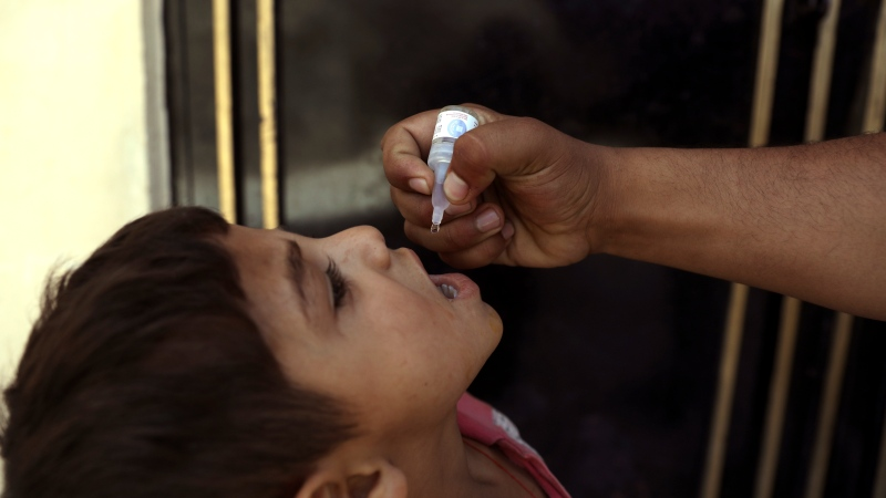 In this June 15, 2021 file photo, a health worker administers a vaccination to a child during a polio campaign in the old part of Kabul, Afghanistan. (AP Photo/Rahmat Gul, File)