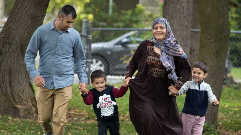Parwaiz Hamidy, Rahima Hamidy and their children Anam, four, (right) and Hasam, three, are shown in Peterborough, Ont. on Friday, October 15, 2021. The tiring and terrifying journey of the Hamidy family from their rural town in Afghanistan's Parwan province to Peterborough, Ont. has a happy ending. THE CANADIAN PRESS/Fred Thornhill