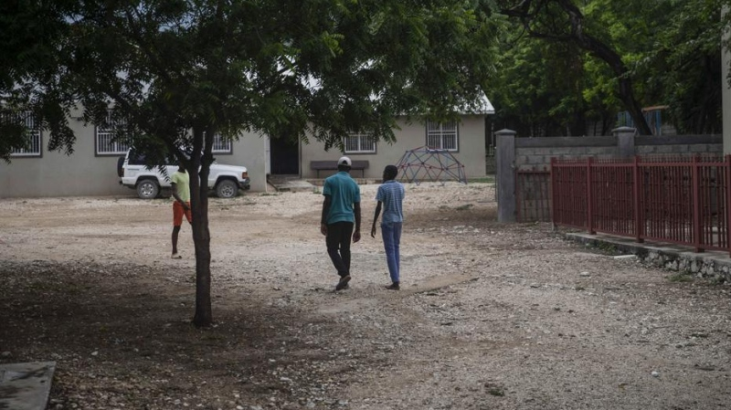 Children walk on the courtyard of the Maison La Providence de Dieu orphanage it Ganthier, Croix-des-Bouquets, Haiti, Sunday, Oct. 17, 2021, where a gang abducted 17 missionaries from a U.S.-based organization. (AP Photo/Joseph Odelyn)