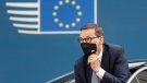 In this Thursday, June 24, 2021 file photo, Poland's Prime Minister Mateusz Morawiecki arrives for an EU summit at the European Council building in Brussels. (Johanna Geron/Pool Photo via AP, File)