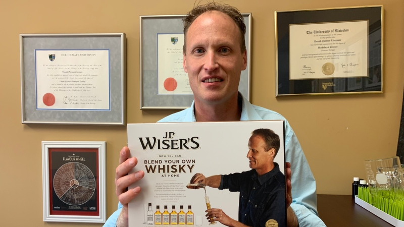 Don Livermore, the master blender at JP Wiser's in Windsor holds a newly released 'Blend Your Own Whisky' kit on Oct. 19, 2021. (Rich Garton/CTV Windsor)