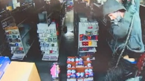 Two people were caught on camera as they rappelled into a store in Oregon, stealing thousands of dollars in merchandise.