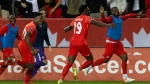 Canada's Alphonso Davies (19) celebrates after scoring against Panama during second half World Cup qualifying action in Toronto on Wednesday, October 13, 2021. THE CANADIAN PRESS/Chris Young