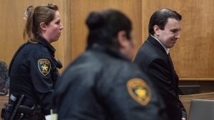 William George Davis, 35, of Hallsville, Texas, is escorted out of the 114th District Court in Tyler, Texas, Thursday, Feb. 20, 2020. (Sarah A. Miller/Tyler Morning Telegraph via AP)