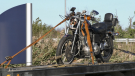 A motorcycle is loaded onto a tow truck after a collision on Horseshoe Valley Road in Springwater Township, Ont., on Tues., Oct. 19, 2021. (Steve Mansbridge/CTV News)
